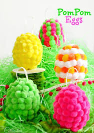 turn plastic easter eggs into bright whimsical pompom egg with ready made pompoms