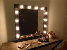 wall makeup mirror and light