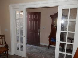 twin glass interior french doors with side panels