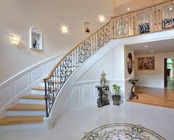 Inspiration for a large timeless painted curved staircase remodel in Boston