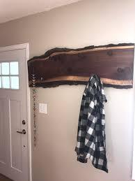 live edge walnut and railroad spike coat rack