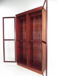 beautifully constructed rosewood display cabinet by noted danish manufacturer skovby unit has eight adjule glass