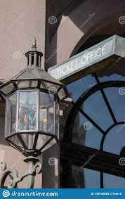 Old Gas Wall Lights Sign That Says Ticket Office On A Stone Building Wall With