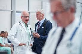 Pharmaceutical Representative Male Pharmaceutical Representative Showing Prescription Medication