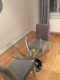 next round glass tulip dining table
