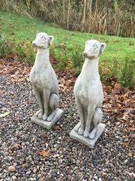 pair of concrete whippet garden statues