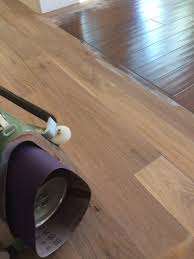 sanding the aluminum oxide off will spread it all over the floor if you don t have a dustless system and or you don t vacuum between cuts the aluminum