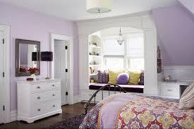 teen girls room with window seat storage