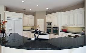 kitchen with angola black granite countertops and white cabinetry