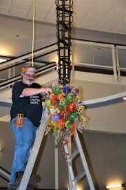 glass artist james hayes puts together his visions of harmony colors of hope chandelier which now hangs in the rotunda of hempstead hall on the campus of