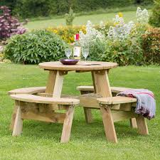 a photo of a 4 seater round picnic table