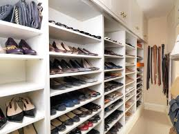 walk in closet with storage for shoes and handbags traditional closet