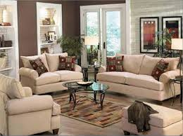 pottery barn living room ideas with cream sofa set and oval glass coffee table on checked