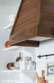 white kitchen with wood range hood diy cover storage