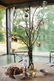 Centerpieces: tall vases with branches and hanging candles- coordinating  flowers replace cotton - to be surrounded by aisle mason jars and vintage  bottle ...