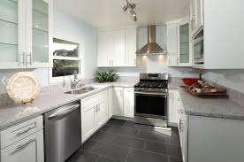 modern kitchen with grey tile floor and white cabinets also white wall paint using marble countertop ideas
