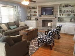 blue living room with whitewashed brick fireplace