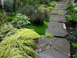 A pebble and stone path with gaps increases permeability. By Jeff Bale.  jeffreygardens.com