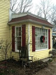 yellow house with shutters yellow house with red door yellow house shutter new white trim work