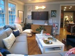 caddy corner furniture like the catty corner couch in front of the windows  and love the