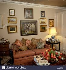 Terracotta Living Room Group Of Pictures Above Terracotta Sofa Piled With Colourful