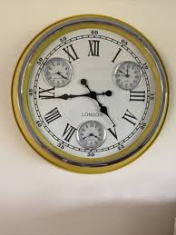 wall clock with integral hanger