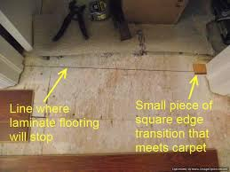 use a small piece of transition to mark each side of the doorway so you will