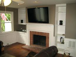 mounting flat screen tv above fireplace wall mounted stand over white fireplace among white stained wooden