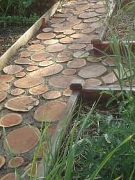 this diy backyard walkway was created to keep little feet safe from sharp objects in the yard it is more like a slightly raised boardwalk