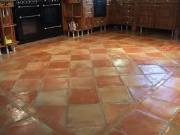 terracotta floor tiles like the border w diamond shaped in middle fired earth old cottage on terracotta floor tiles