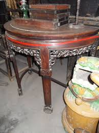 known in chinese as a half round table 半圆桌 this particular one is made from huali a hardwood similar to rosewood also from beijing these two