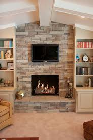 stacked stone veneer with built in bookcases and candle decorating ideas also recessed lighting plus ethanol