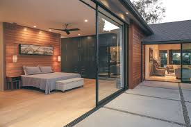 one of two massive pocketing series 600 multi slide door in the master suite increase the residents living space