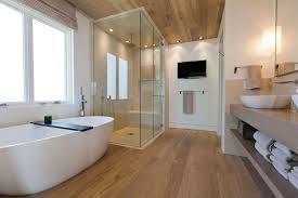 laminate bathroom flooring with wooden ceiling planks and decorative towel storage