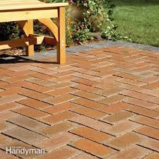 Cover concrete patio ideas Painting How To Cover Concrete Patio With Pavers The Family Handyman How To Cover Concrete Patio With Pavers The Family Handyman