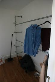here is where i realized that the space was much too short for richard s shirts so we had to un it all take back the pipes and get longer ones