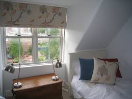 makeover of two attic bedrooms including flooring wall colours and soft furnishings with custom made lamp shades matching the blinds and cushions