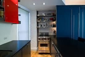 under counter fridge kitchen modern with black countertops blue cabinets