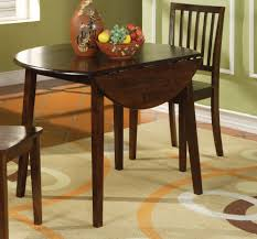 small round wood drop leaf kitchen table painted with dark brown color plus 2 chairs for rustic modern kitchen ideas