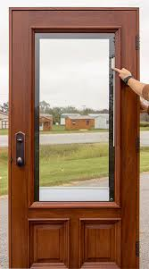 operate doors with shades between glass