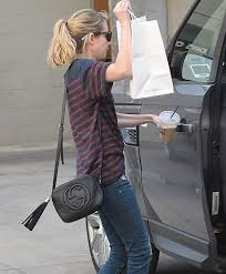 gucci disco bag. emma roberts was recently spotted carrying a black gucci soho disco bag while getting takeout from popular la eatery joan\u0027s on third. | pinterest