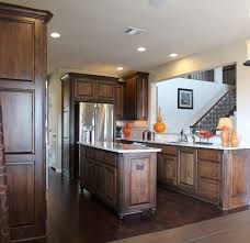 Kitchen Cabinets With Feet Burrows Cabinets Kitchen In Stained Knotty Alder Island With Bunn