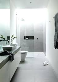 big floor tiles grey floor tile that continues up the wall of the shower white tiling