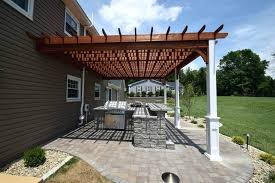 wood pergola white posts over patio outdoor kitchen why should you get a