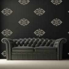 white damask wall decals placed evenly as a pattern on a black wall above