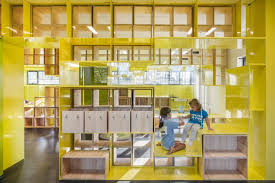 Walls With Integrated Furniture And Yellow Nooks Encourage Play In Extraordinary Furniture Design Schools