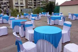 blue round tables sky outdoors catering photos moshi pune caterers