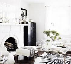 decorating rustic home decor with wall decor above fireplace and faux cowhide rug on hardwood flooring