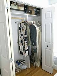 bedroom closet with clothes hanging inside