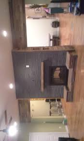 a double sided reclaimed wood and stone fireplace is a magnificent centerpiece for your home